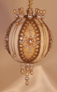 Signature lacing and Swarovski crytals come together on this heirloom Victorian ornament by Orna Mentz